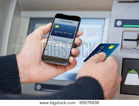 Man Holding Phone With Mobile Wallet At The Atm