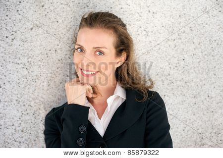 Attractive Business Woman Smiling With Hand On Chin