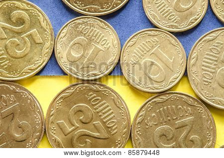 Ukrainian coins on blue and yellow background