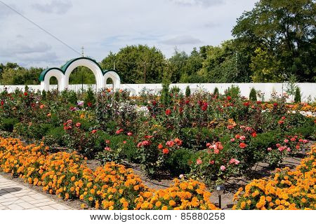 Magnificent Flower Garden With Roses, Marigolds On Church Grounds