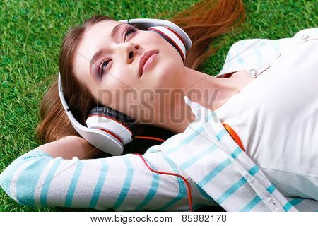 Young woman listening to the music .