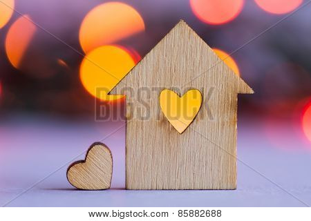 Wooden House With Hole In The Form Of Heart With Little Heart On Bokeh Background