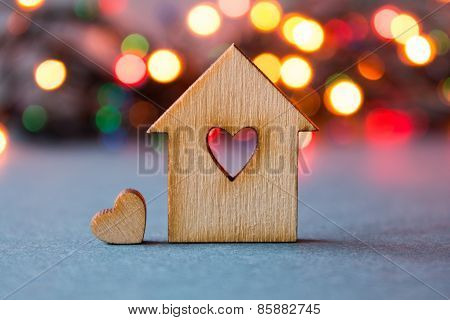 Wooden House With Hole In The Form Of Heart With Little Heart On Bright Bokeh Background