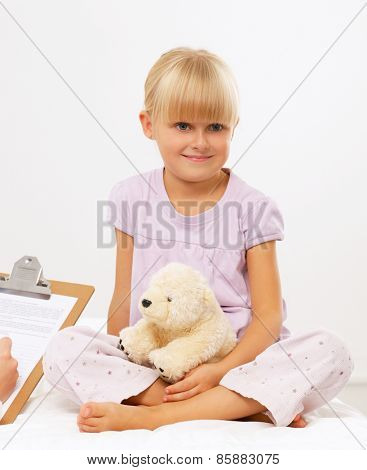 Female doctor examining child with stethoscope at surgery,isolated