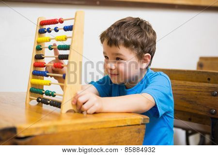 Student doing maths on abacus at elementary school