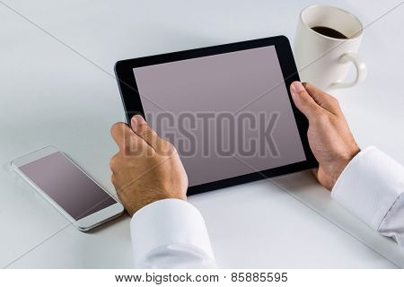 Businessman using his tablet pc in close up