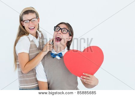 Excited geeky hipster and his girlfriend on white background