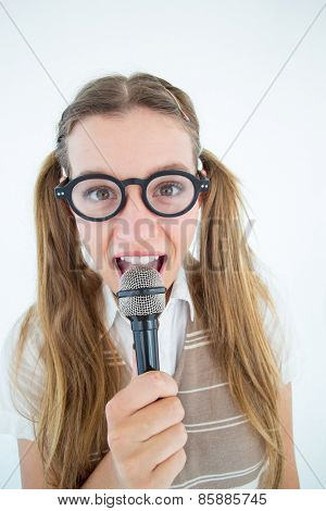 Happy geeky hipster singing with microphone on white background