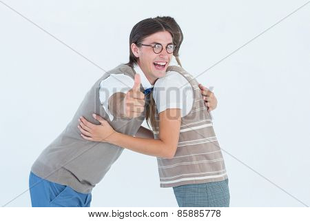 Geeky hipster couple hugging on white background