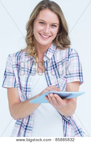 Pretty hipster using tablet on white background