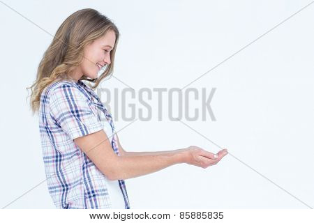 Pretty hipster presenting her hands on white background