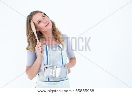 Thoughtful woman holding saucepan on white background