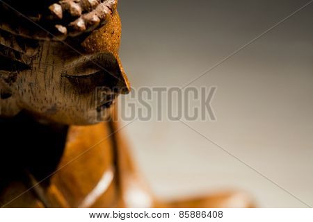 Buddha statue on a table shot in studio