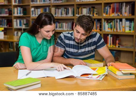 Students studying together in the library at the university