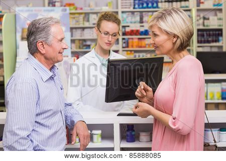 Costumers talking to each other at pharmacy