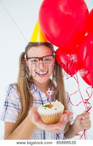 Geeky hipster celebrating birthday party on white background