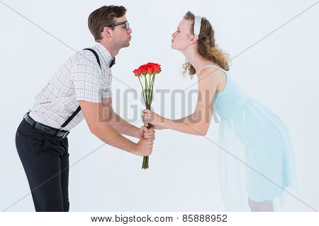Geeky hipster couple holding roses and kissing on white background