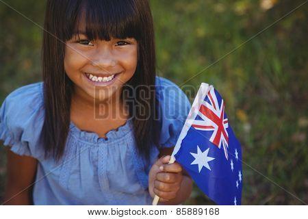 Cute little girl with australian flag on a sunny day