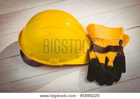 Hard hat and protective gloves shot in studio
