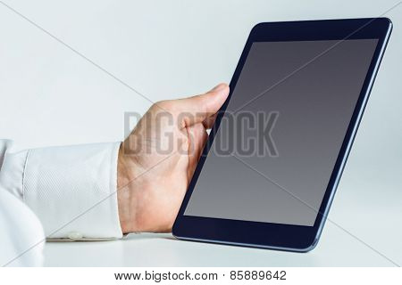 Man using a tablet pc in close up