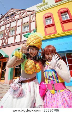 Dancers in costumes participate in a parade
