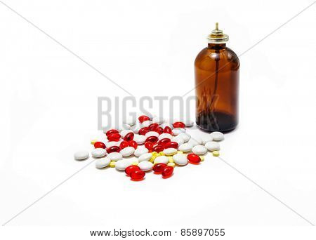 medication pills and bottle laying over white background