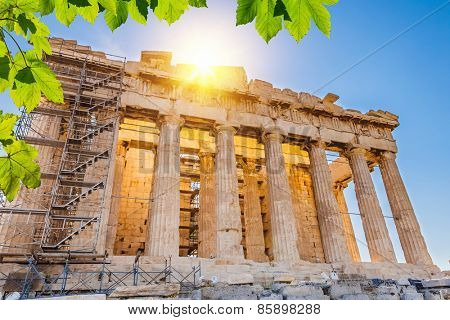 Sun over Parthenon in Acropolis, Athens, Greece