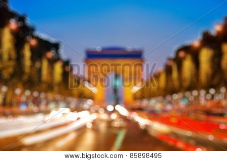 Bokeh of Arch of Triumph at night in Paris, France