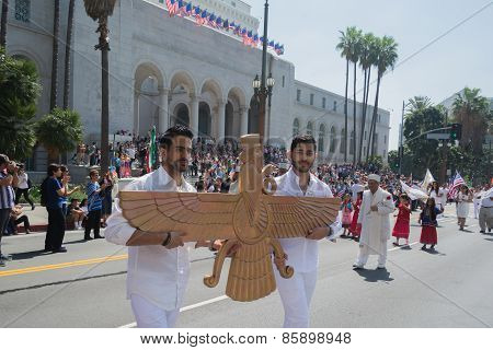 Men Holding A Sculpture Of Faravahar, Iranian Symbol