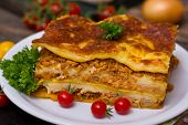 foto of lasagna  - A slice of lasagna on the plate close up - JPG
