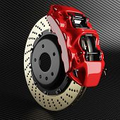 Постер, плакат: Automobile Brake Disk And Red Caliper On Carbon Background