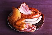 picture of deli  - Assortment of deli meats on metal tray on color wooden background - JPG