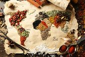pic of spice  - Map of world made from different kinds of spices on wooden background - JPG