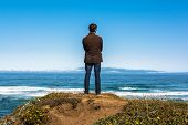 stock photo of mendocino  - A man on the rock who was looking at the ocea - JPG