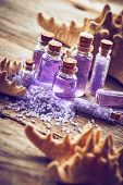 picture of gels  - Bottles with shower gel sea salt and starfish on wooden background - JPG