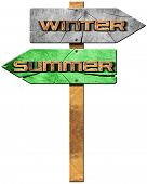 image of directional  - Wooden directional sign with two arrows in opposite direction with text summer and winter isolated on white background - JPG