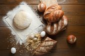 picture of quail  - Fresh dough with flour on a paper napkin decorated with rye bread flour - JPG