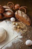 stock photo of quail  - Fresh dough with flour on a paper napkin decorated with rye bread flour - JPG