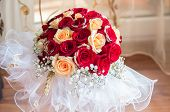 stock photo of wedding feast  - Wedding bouquet of red and yellow roses - JPG