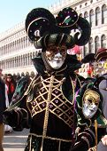 picture of venice carnival  - A character in a colorful costume at the carnival in Venice - JPG