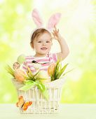 image of hare  - Child Girl in Bunny Ears Basket with Eggs Little Kid Dressed Pink Rabbit Ear Funny Baby in Hare mask over Green Background - JPG