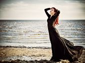 picture of gothic girl  - Beautiful goth girl standing on the sea beach - JPG