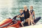 pic of jet-ski  - People enjoying a ride on a personal watercraft  - JPG