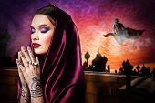 picture of mehendi  - beautiful woman in oriental style with mehendi praying - JPG