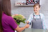 stock photo of flower shop  - Let me take your card - JPG