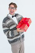 pic of jacket  - Happy geeky hipster with wool jacket holding present on white jacket - JPG