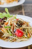 picture of green papaya salad  - Thai spicy papaya salad serve with vegetables - JPG