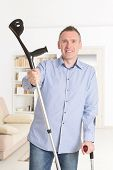 picture of crutch  - Man with crutches - JPG