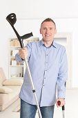 pic of crutch  - Man with crutches - JPG