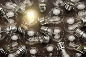 stock photo of uniqueness  - glowing bulb uniqueness concept - JPG